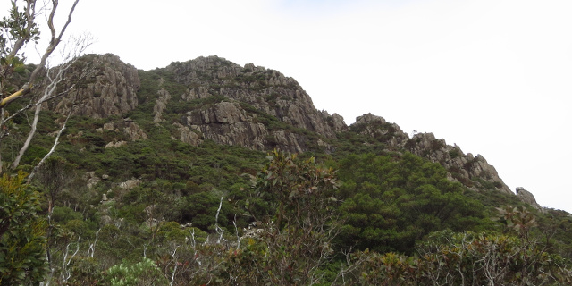 Photograph of jagged mountain from below