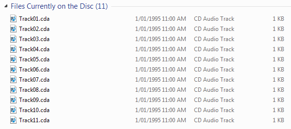 "Windows directory listing, showing ""Files Currently on the Disc (11)"" with files from ""Track01.cda"" up to ""Track11.cda""."